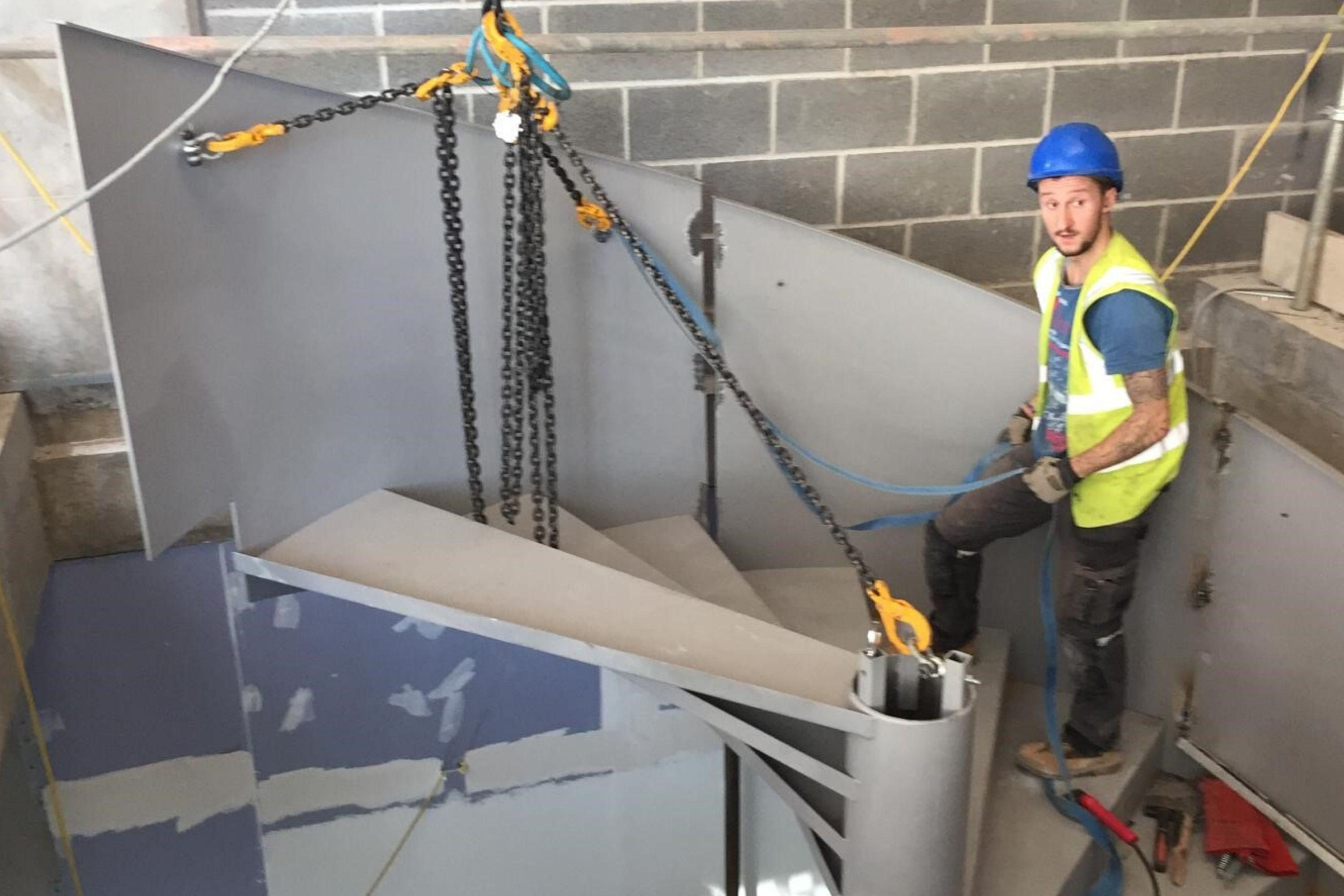 Fitter installing a stair