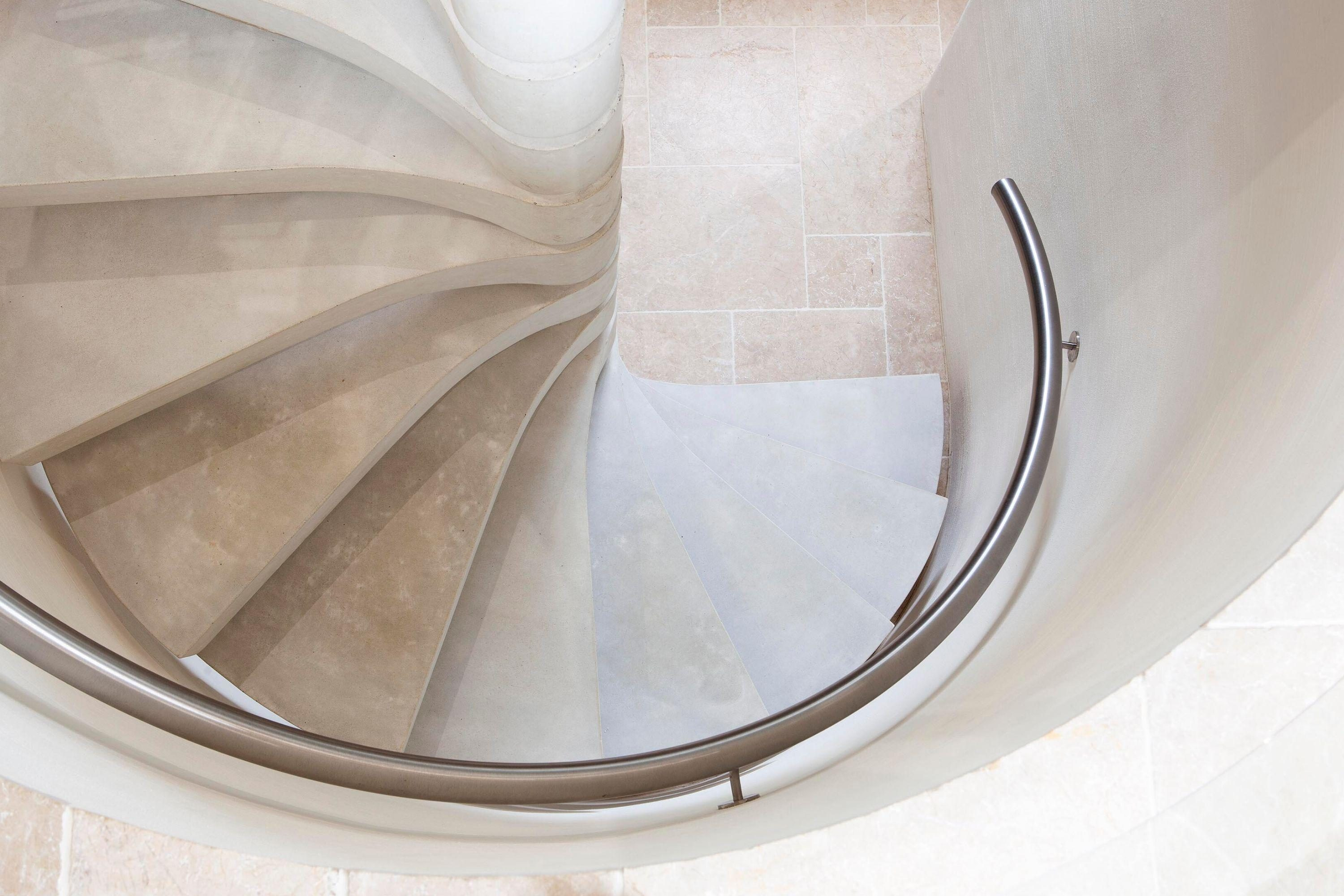 Concrete spiral stair and handrail