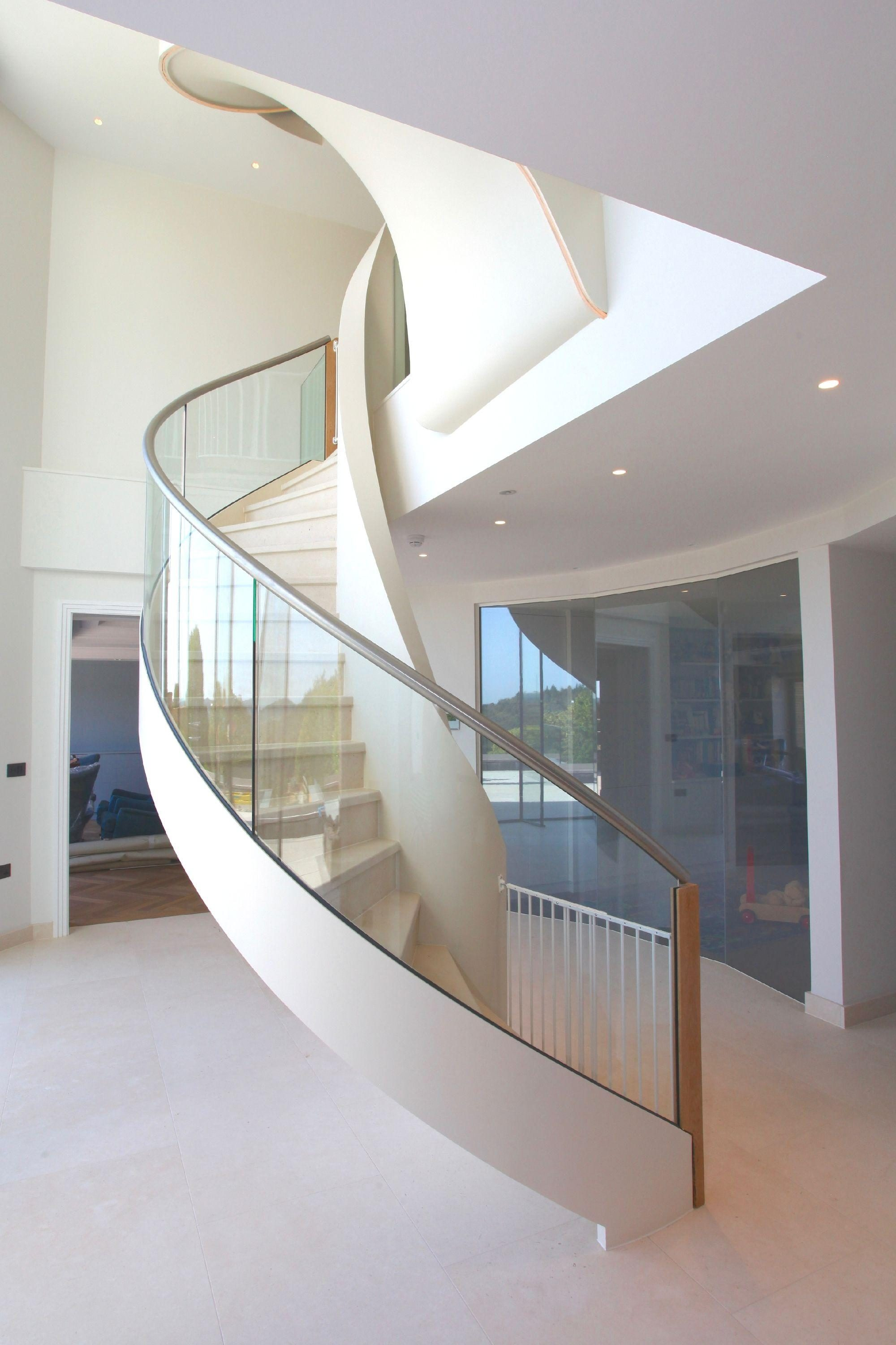 Elliptical stair with glass balustrade