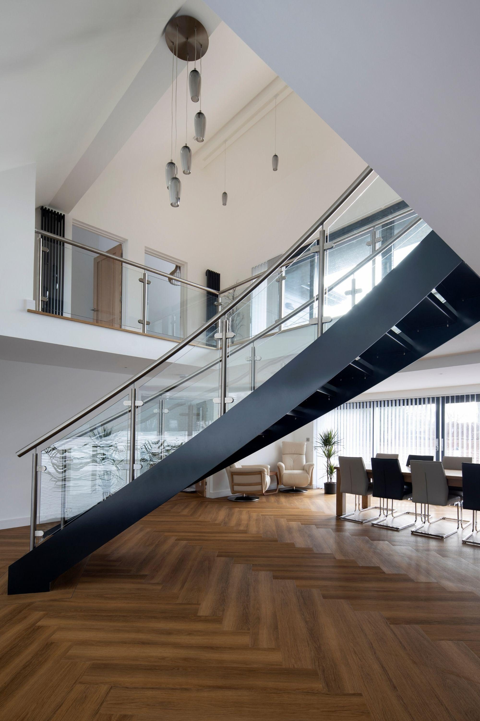 Grey stringers on curved staircase