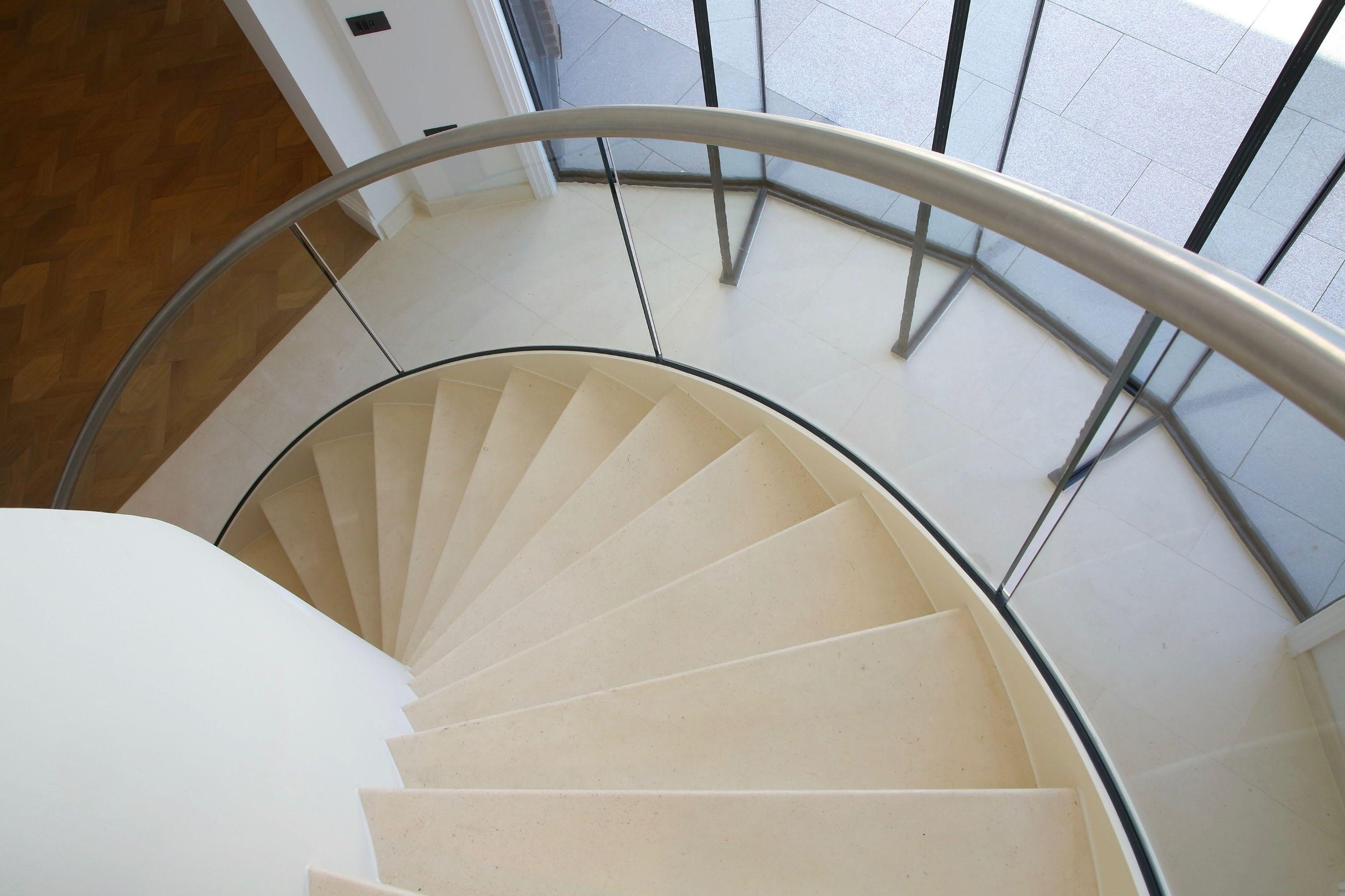 Descending curved staircases