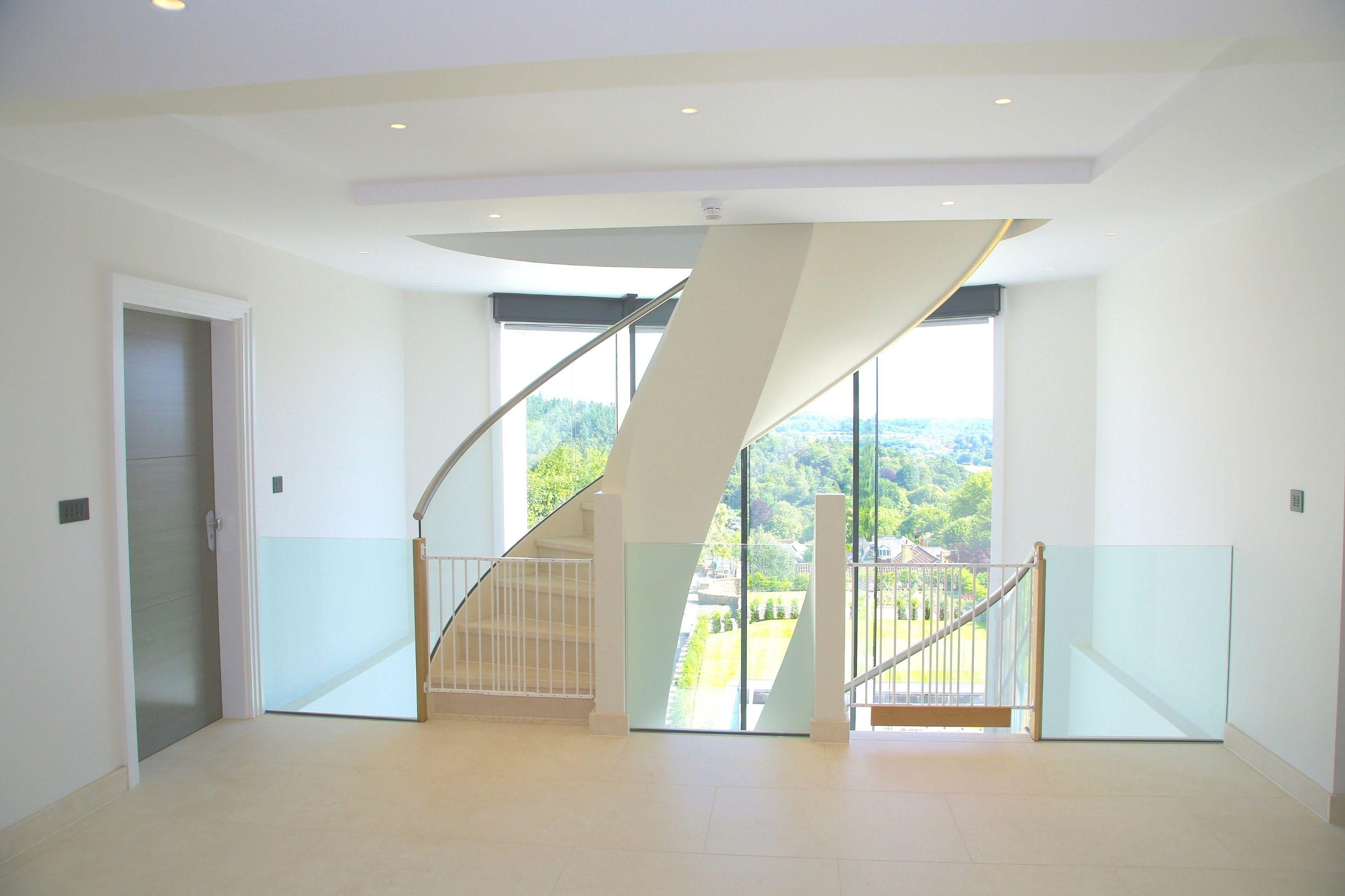 Curved stairs with glass balustrade