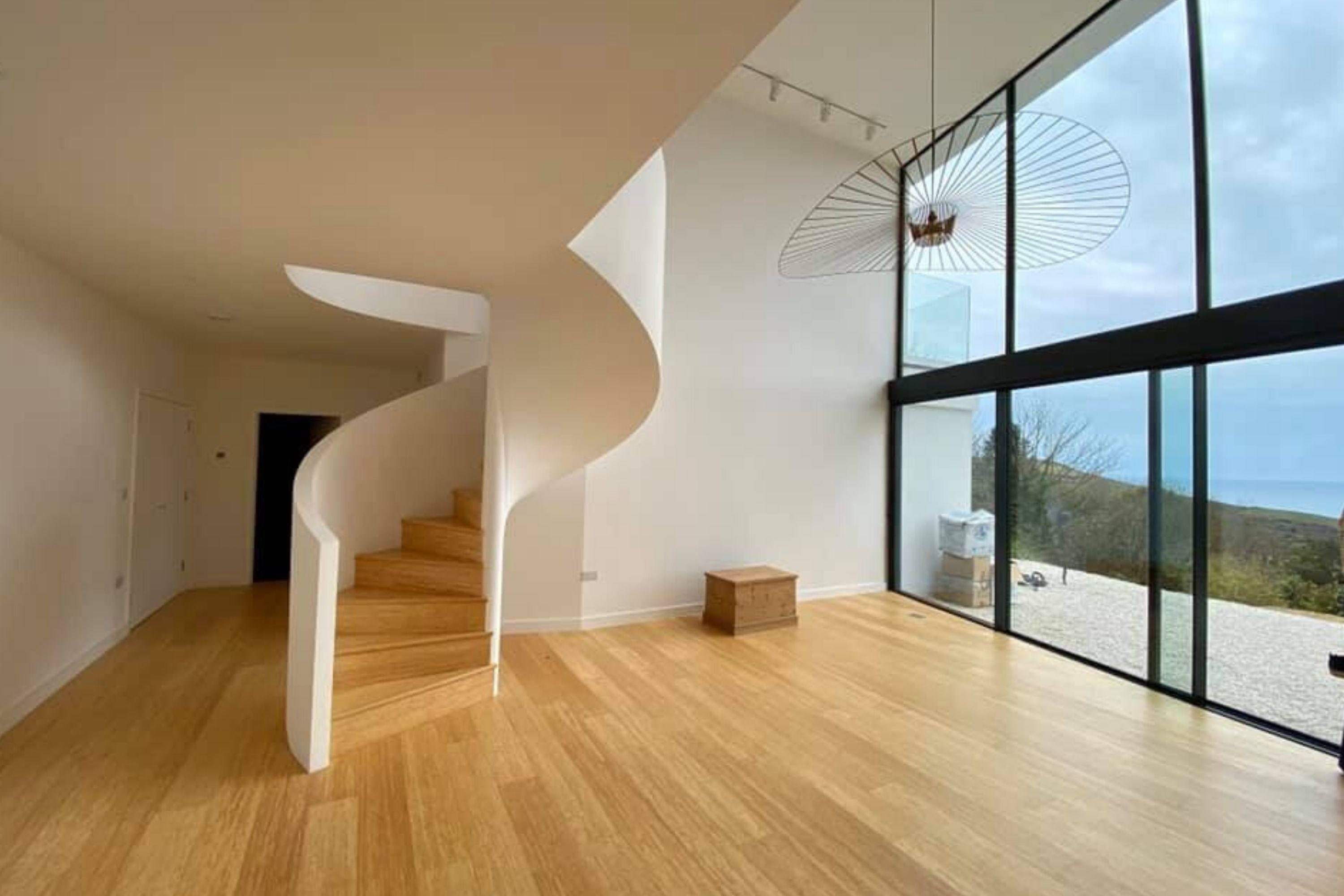 Timber treads and plaster balustrade on spiral stairs