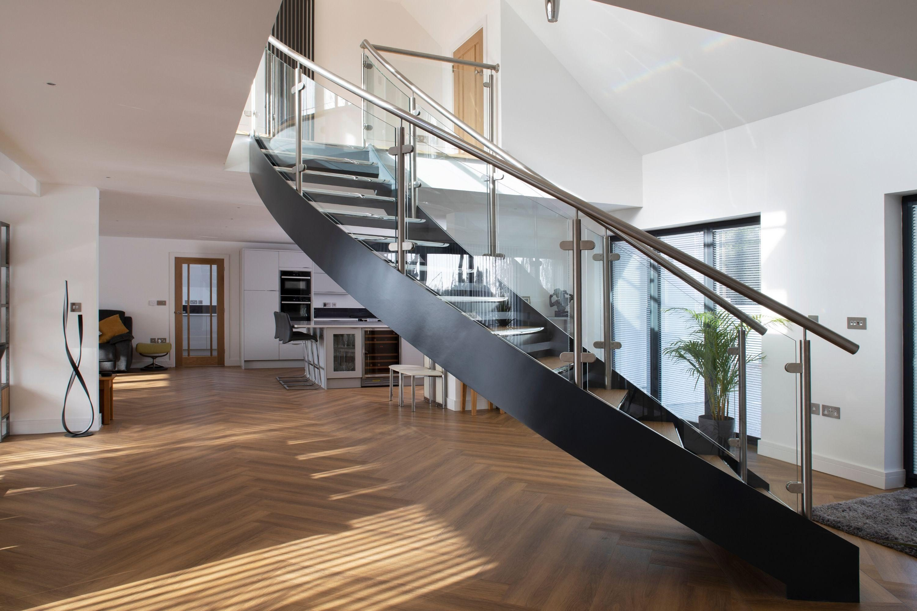 Helical stairs with glass balustrade