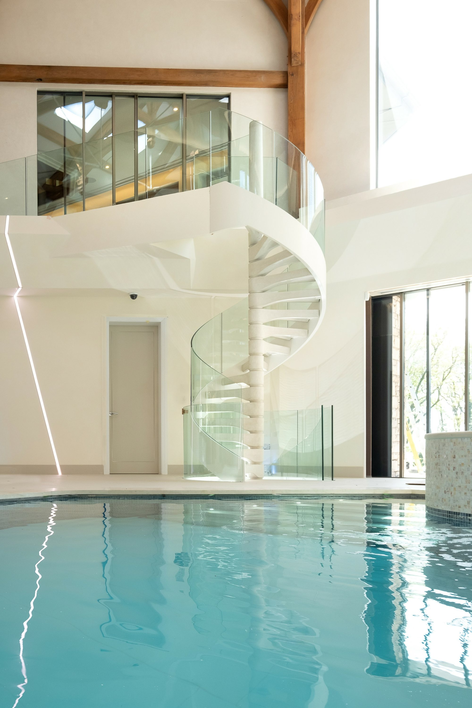 Concrete spiral staircase by pool