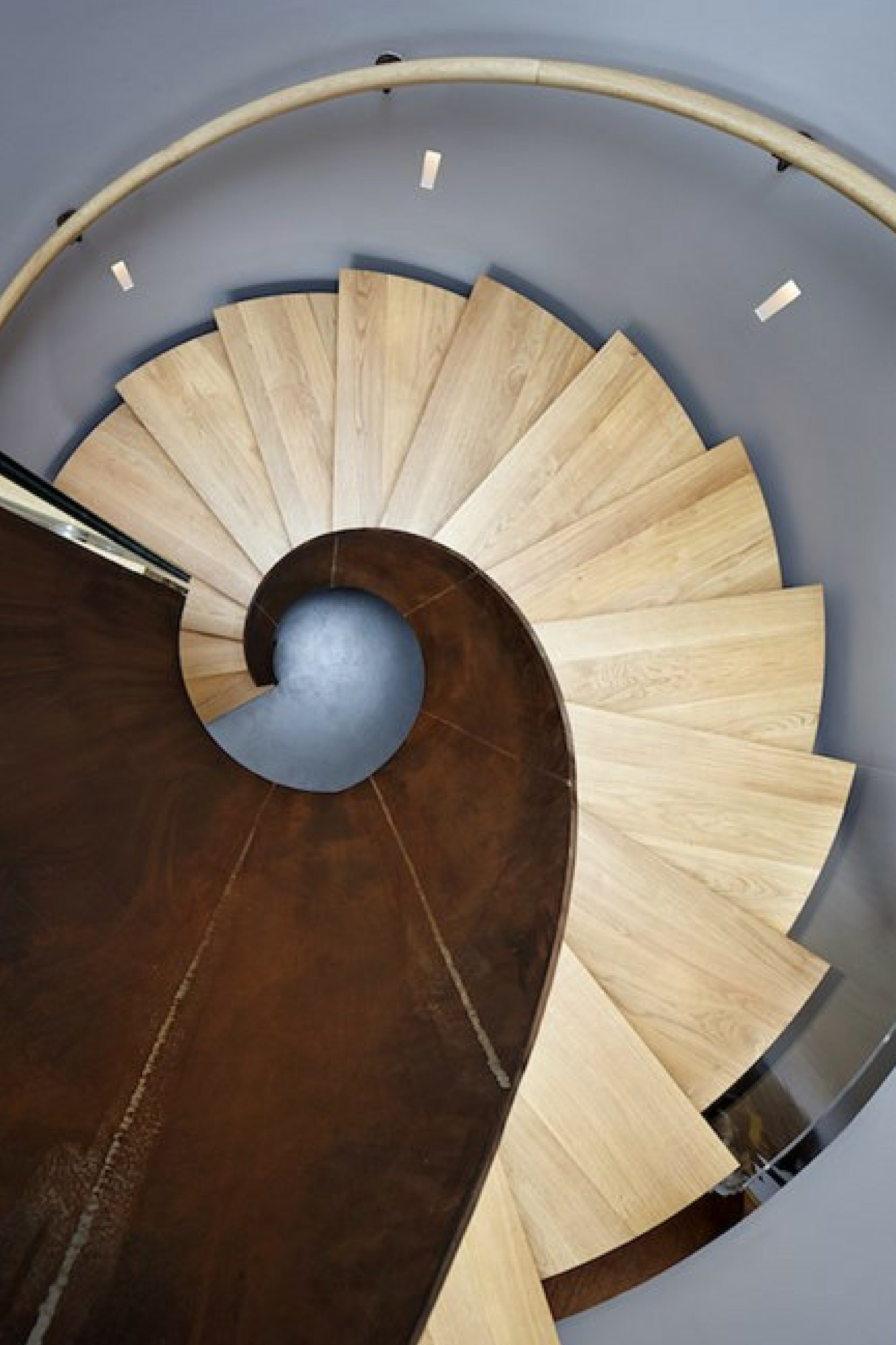residential curved staircase with timber treads