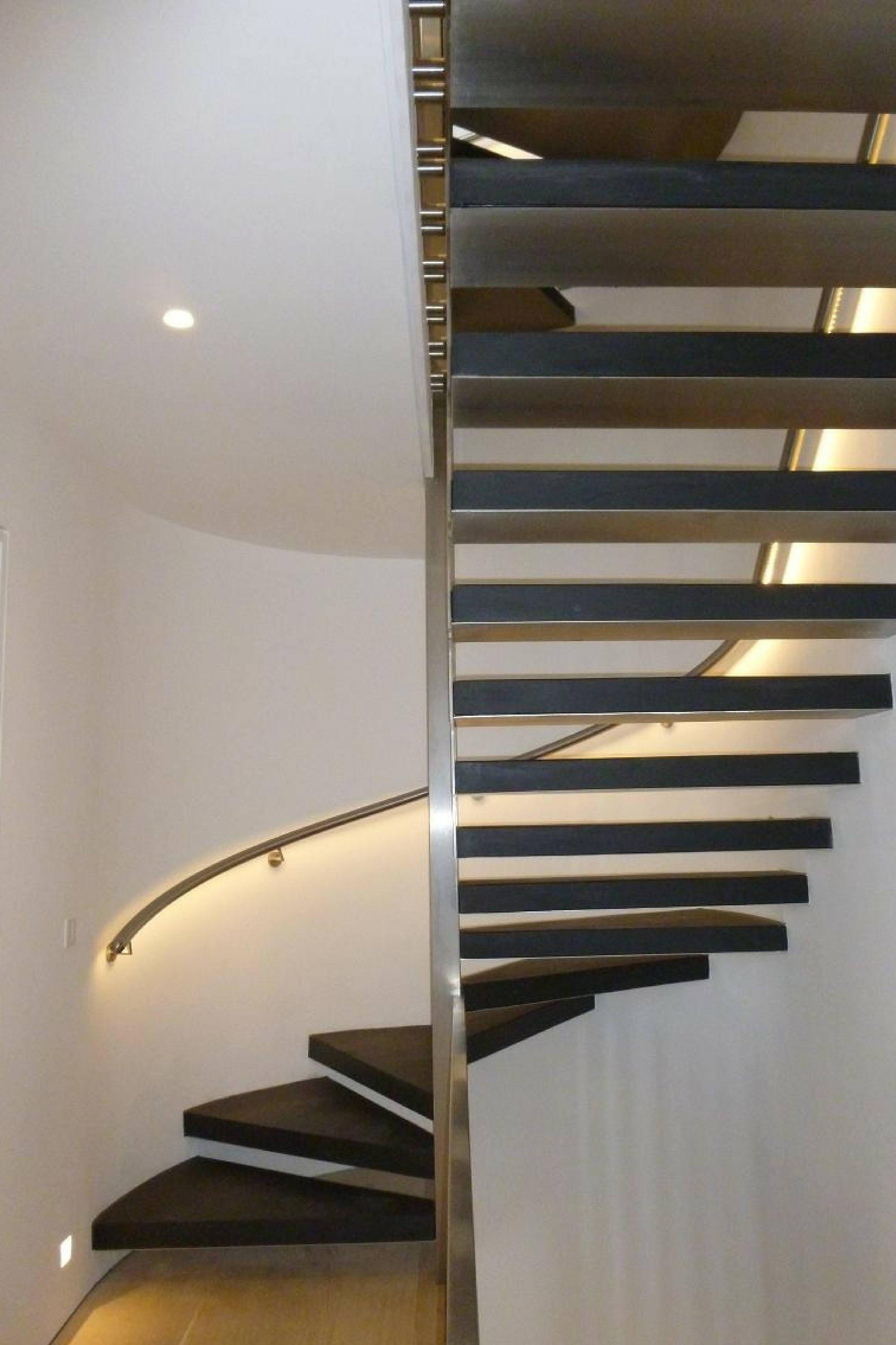 Black tread helical staircase