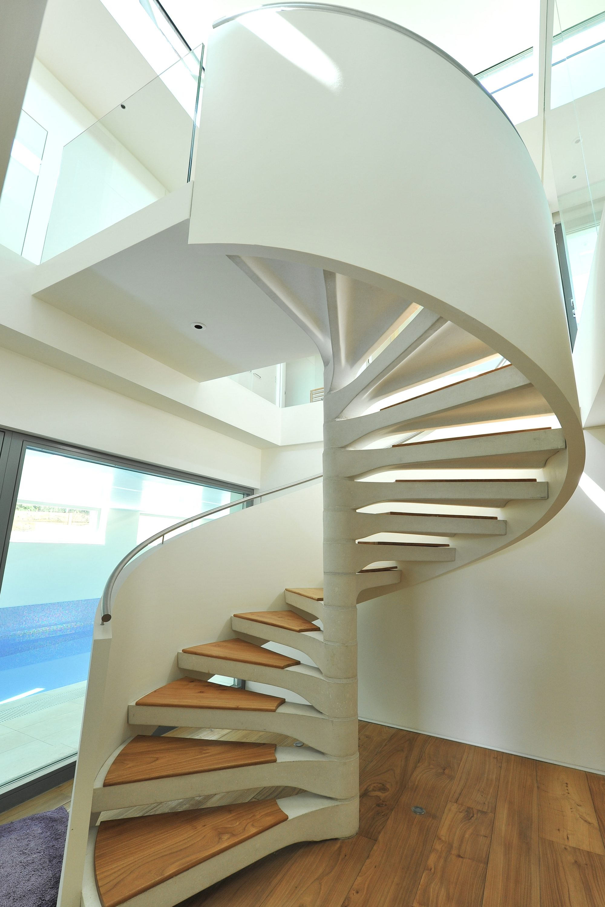 concrete spiral staircase with timber treads