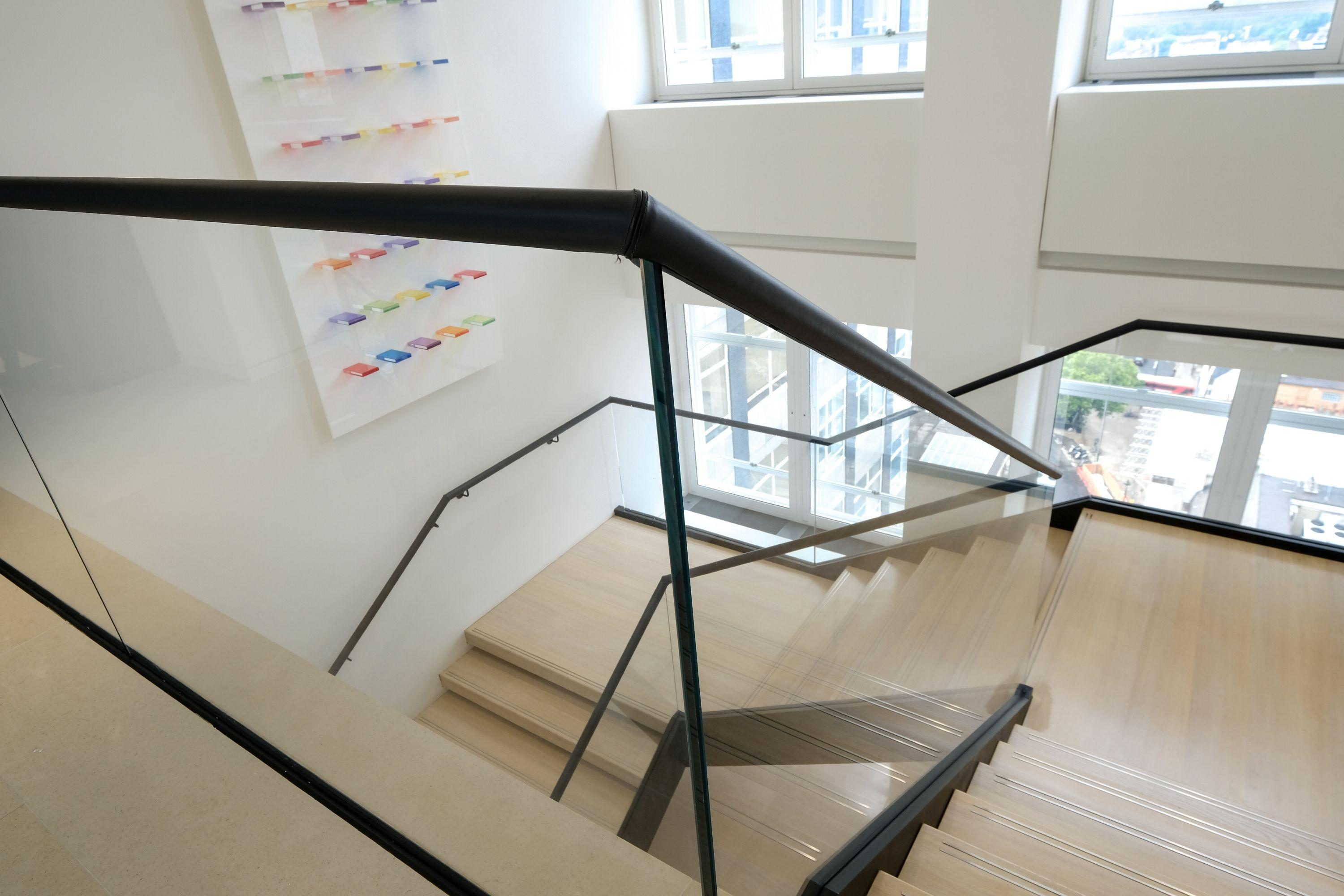 Glass balustrade and leather clad handrails