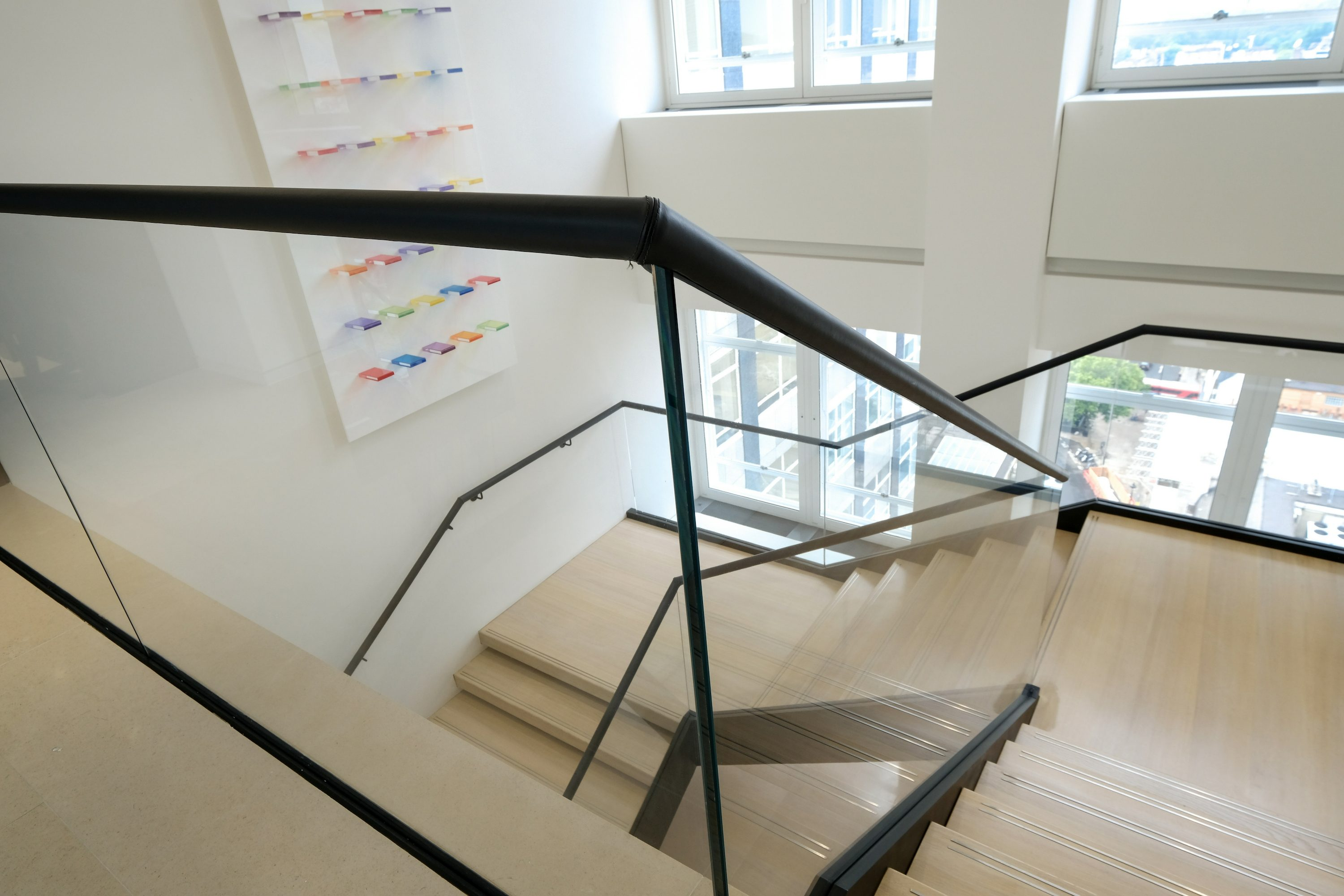 view down a dog-leg office staircase