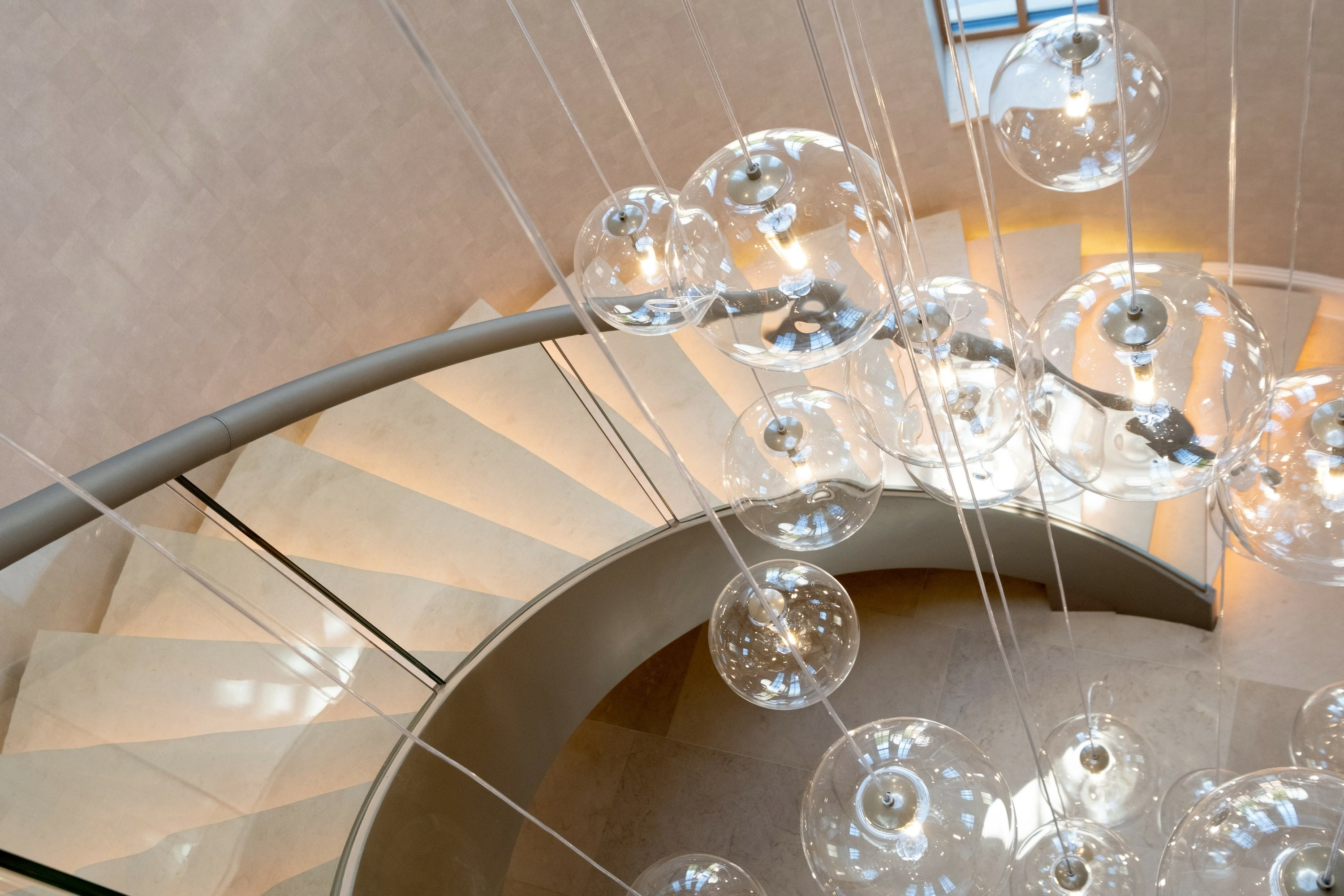 Luxury curved staircase with lights