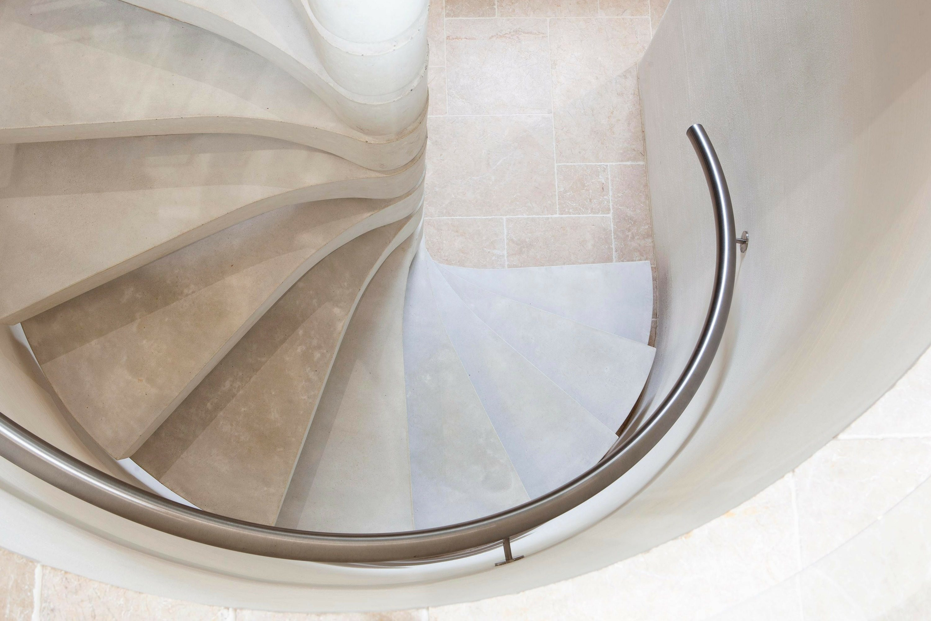 handrail on concrete spiral staircase