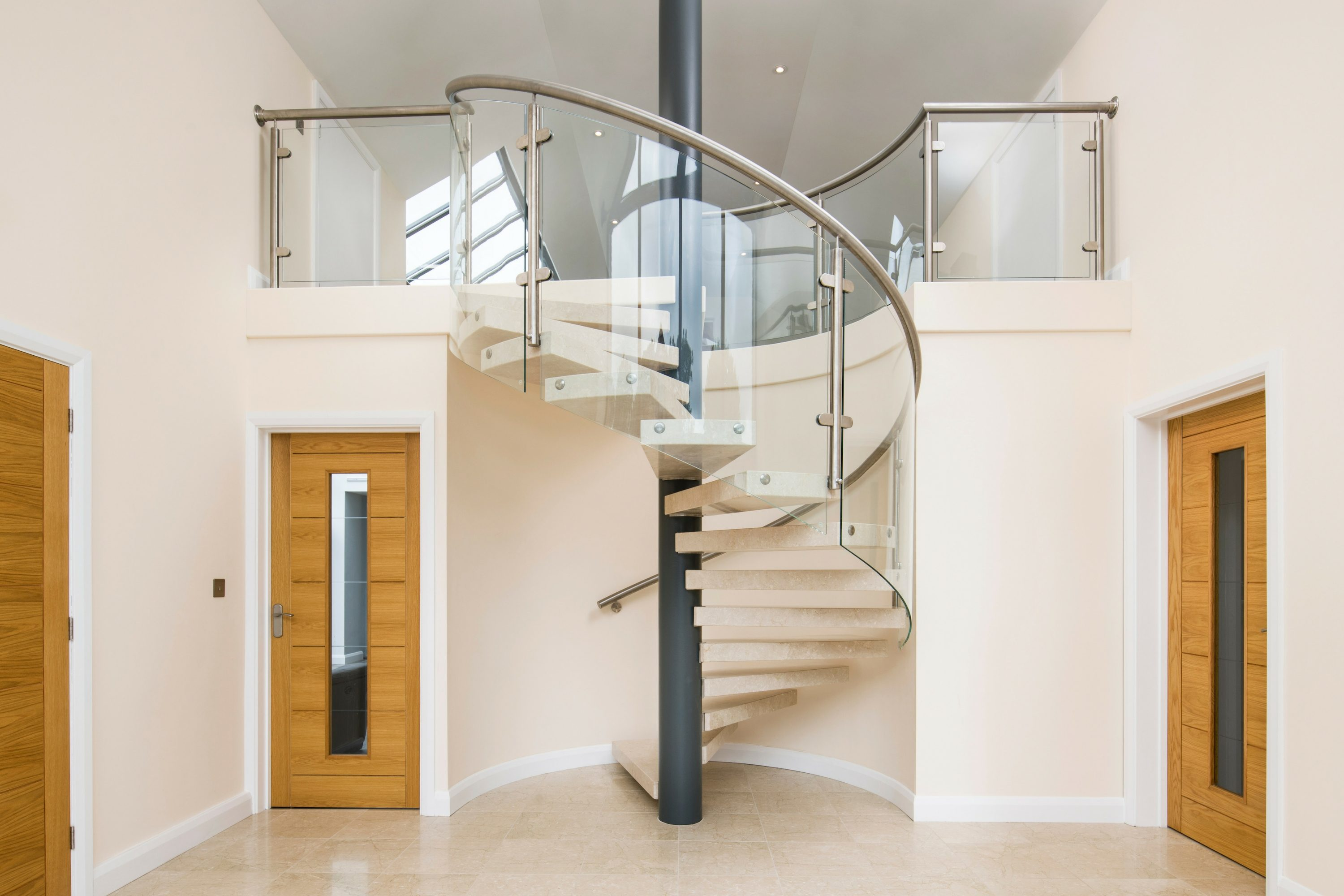 spiral staircase with glass balustrade