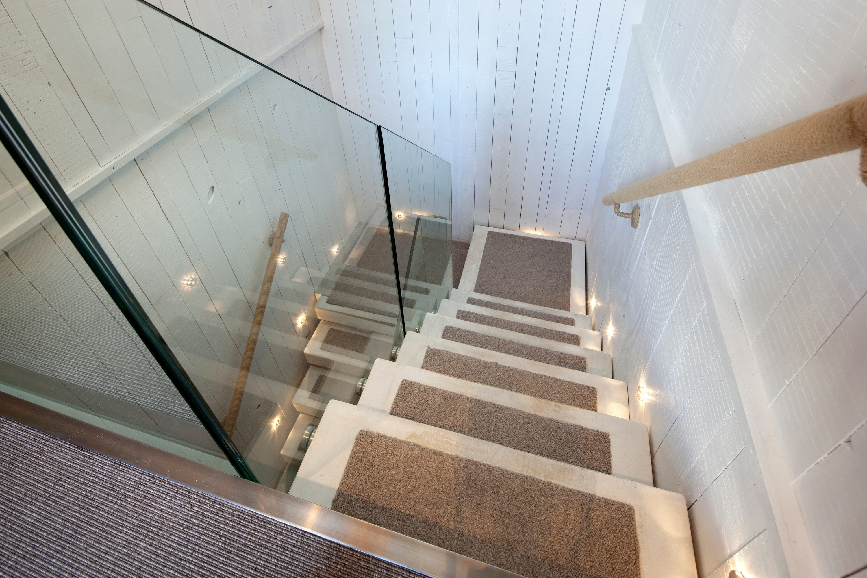 Straight concrete staircase with carpet inlay