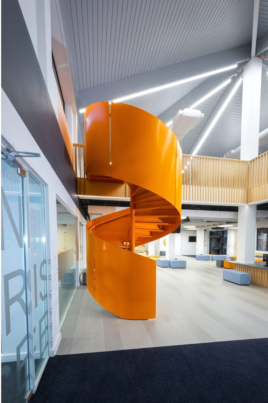 Orange balustrade on spiral stairs