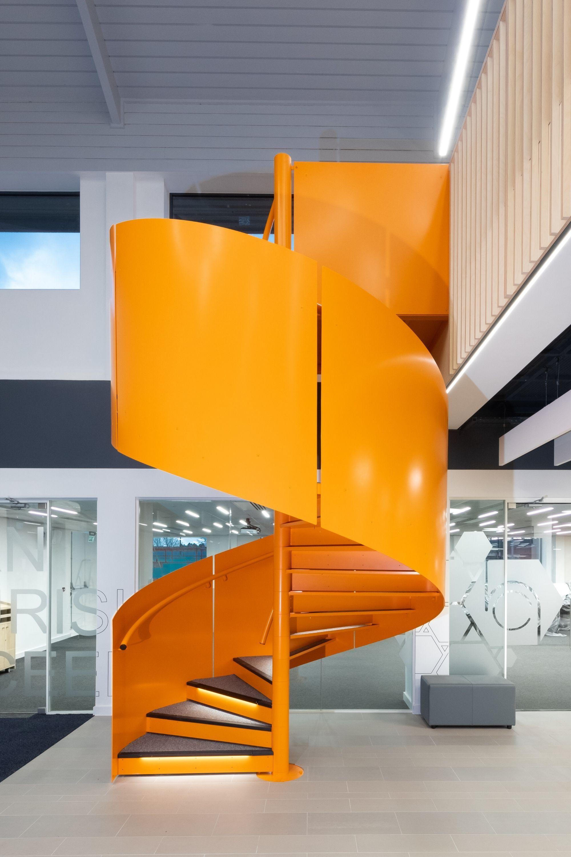 Bright orange spiral staircase