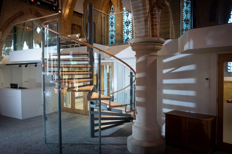 Glass balustrade on spiral staircase