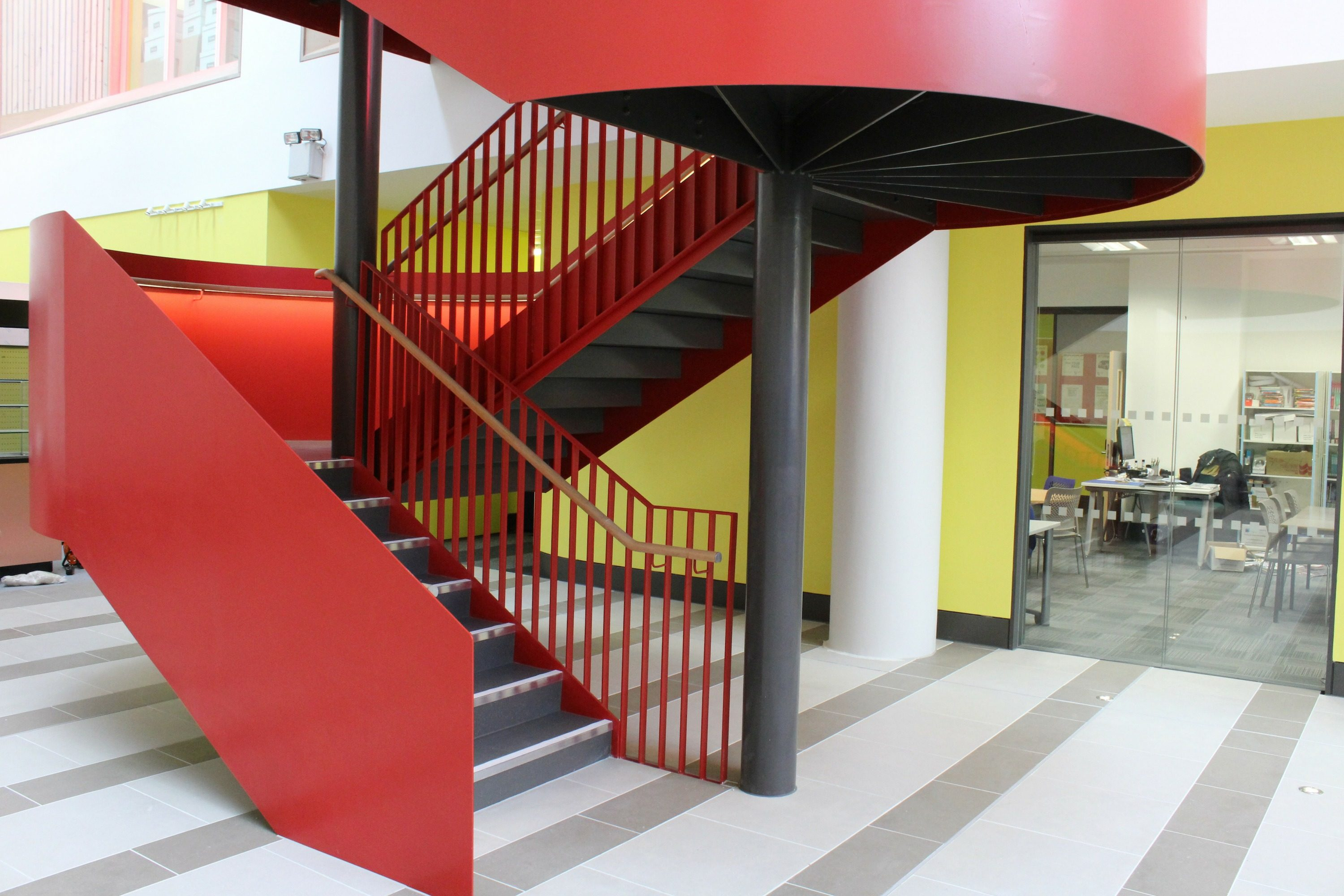 Red balustrade on school staircase