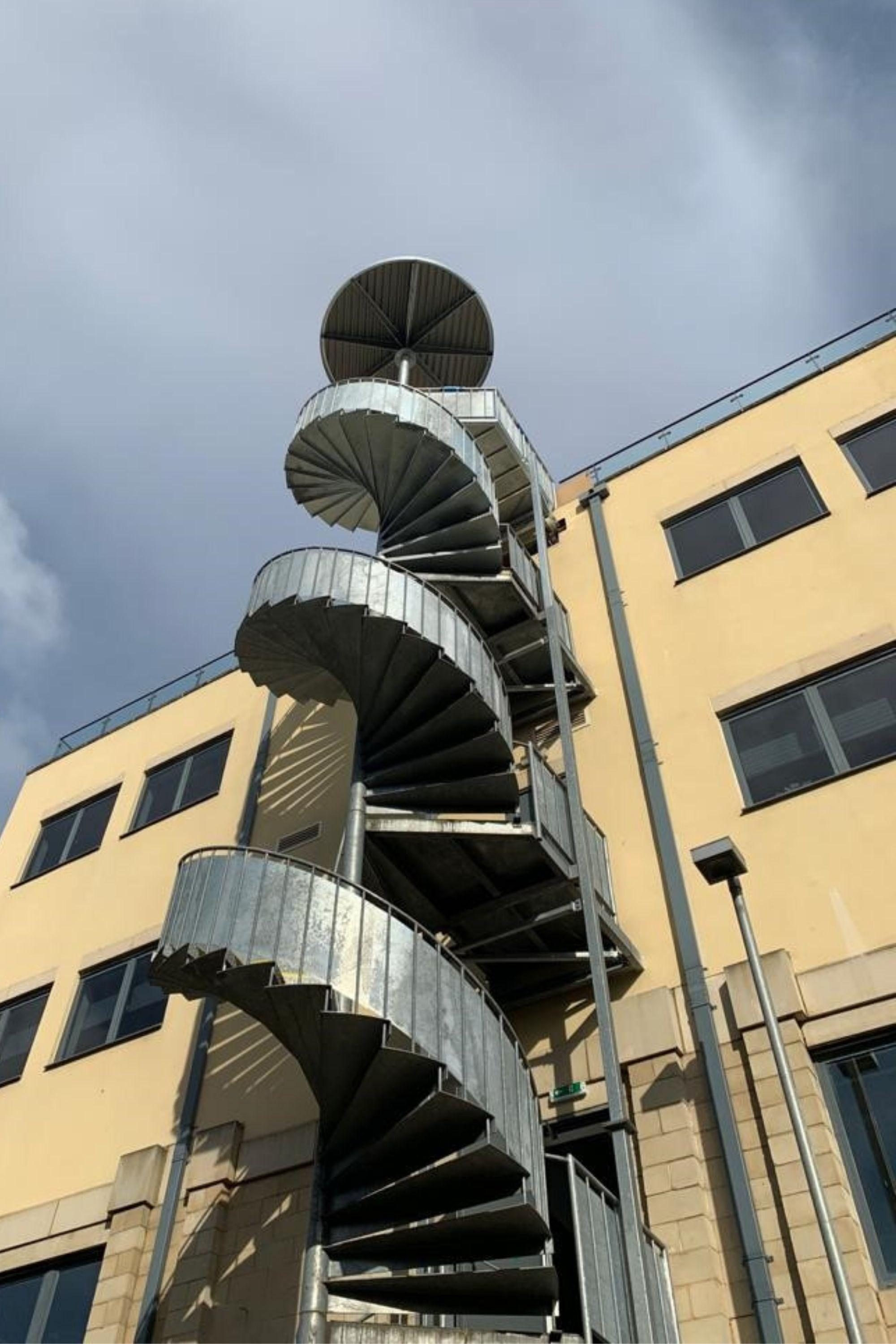 Steel spiral staircase extension