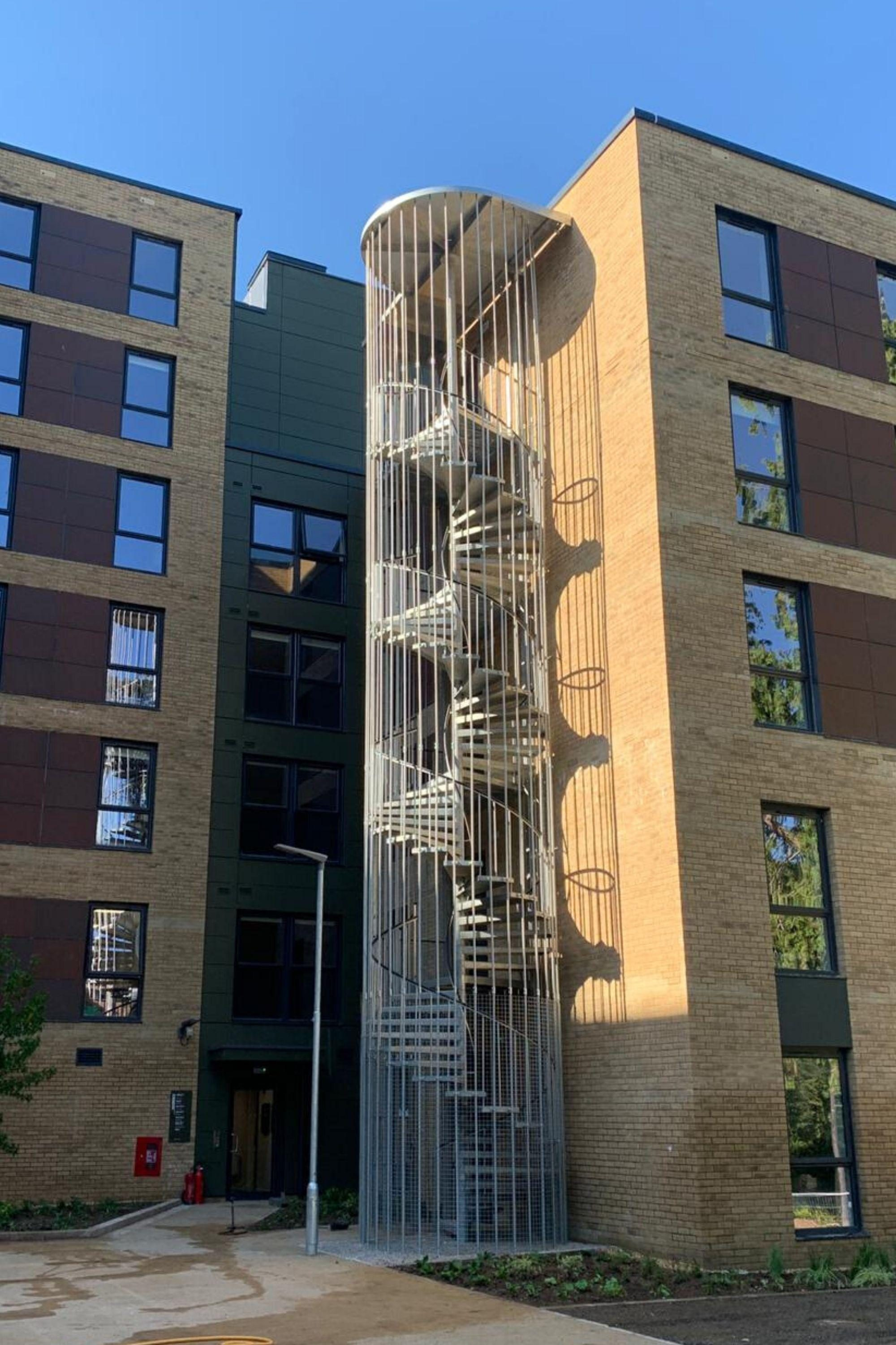 External spiral staircase with enclosure