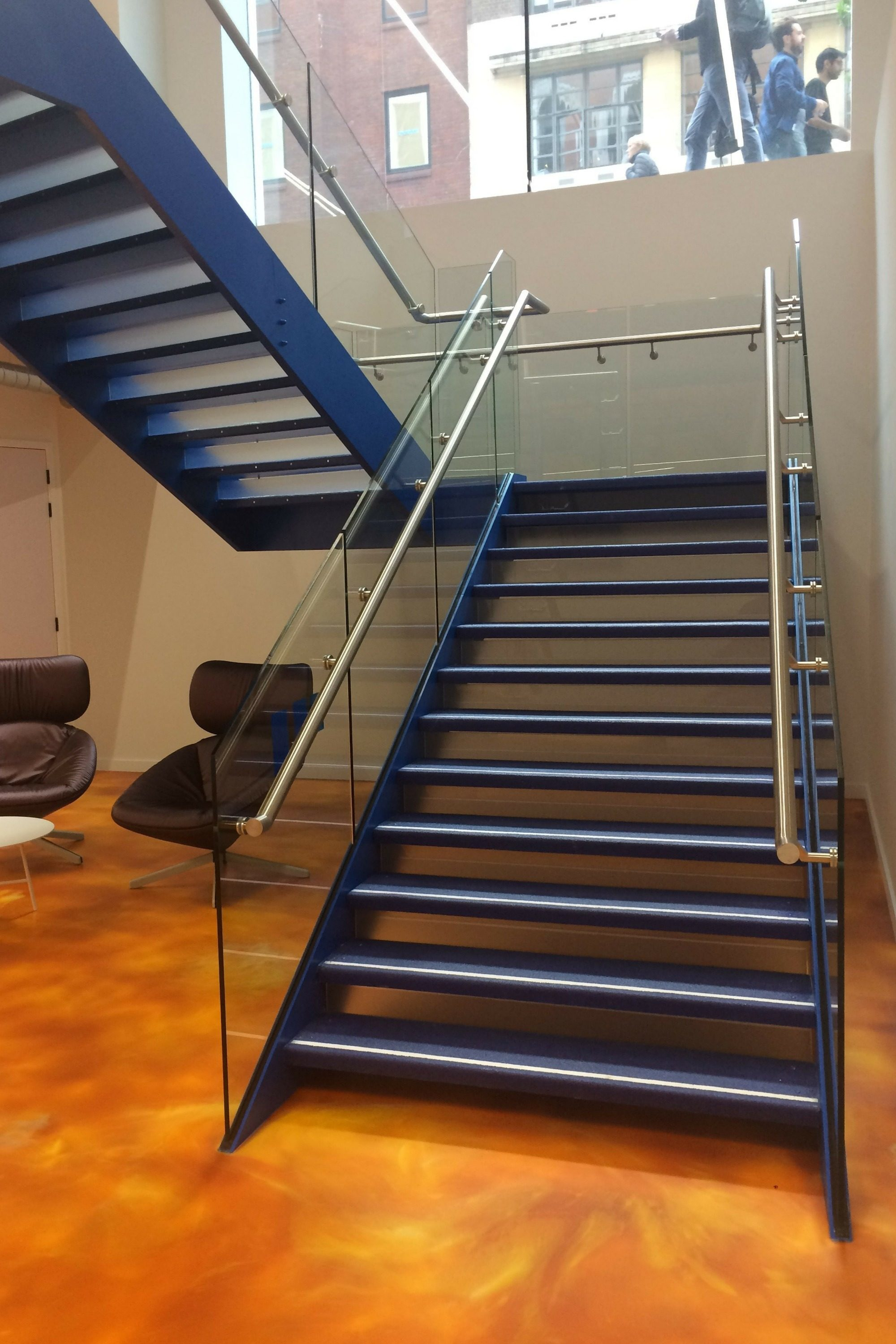Striking blue office stair with gold floor