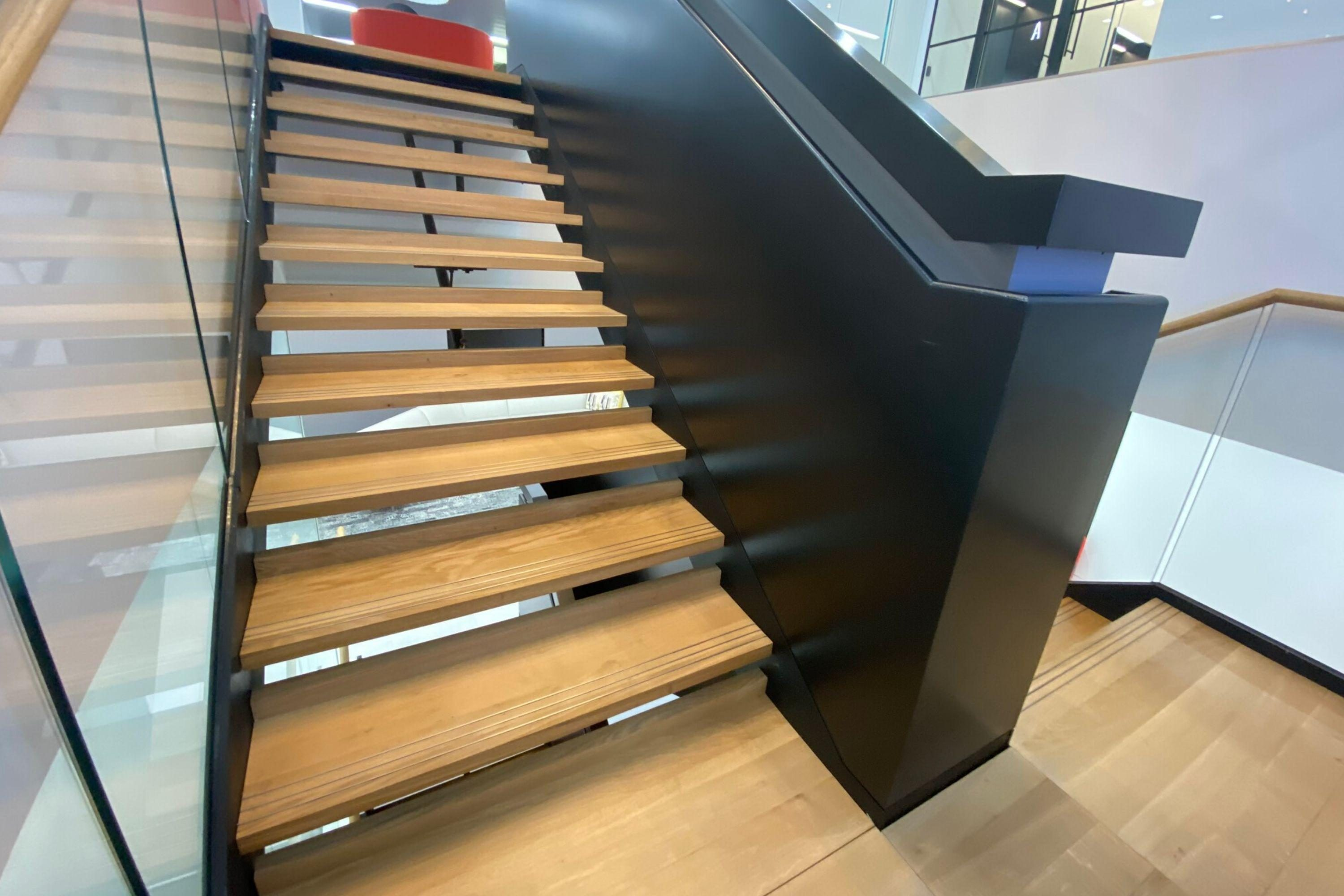 office staircase with timber treads and handrail groove