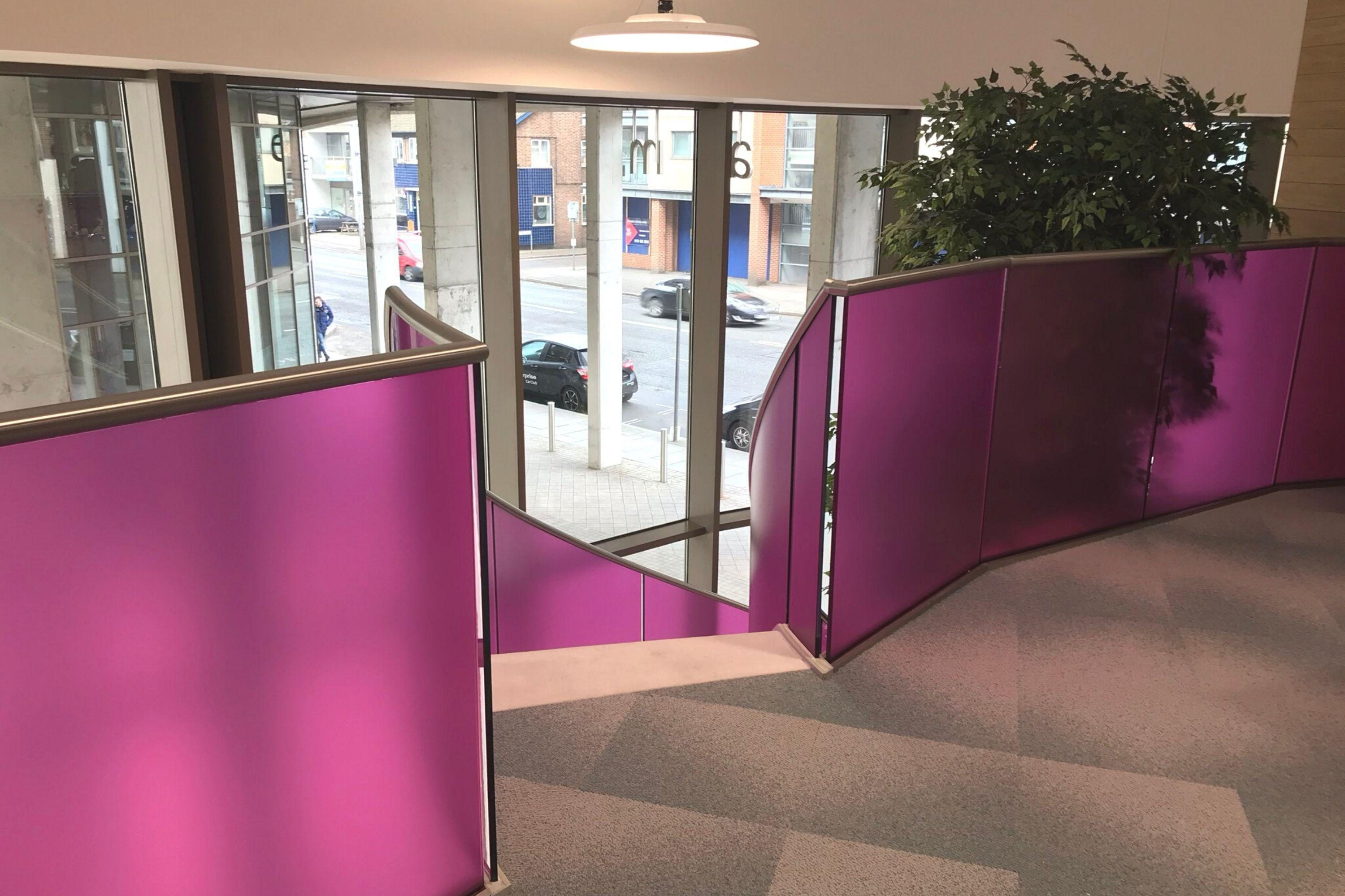 Pink landing balustrade to office staircase
