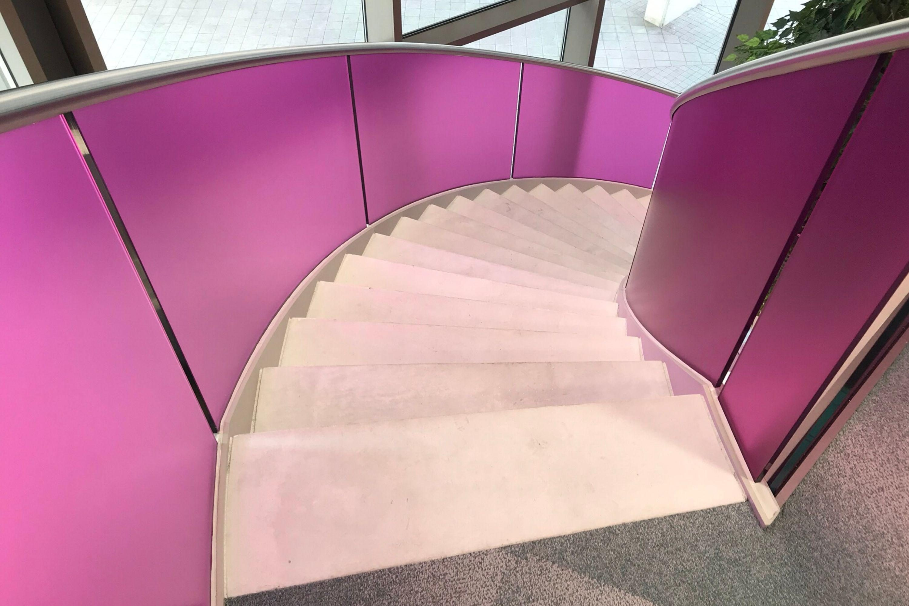 Concrete stairs with pink balustrade