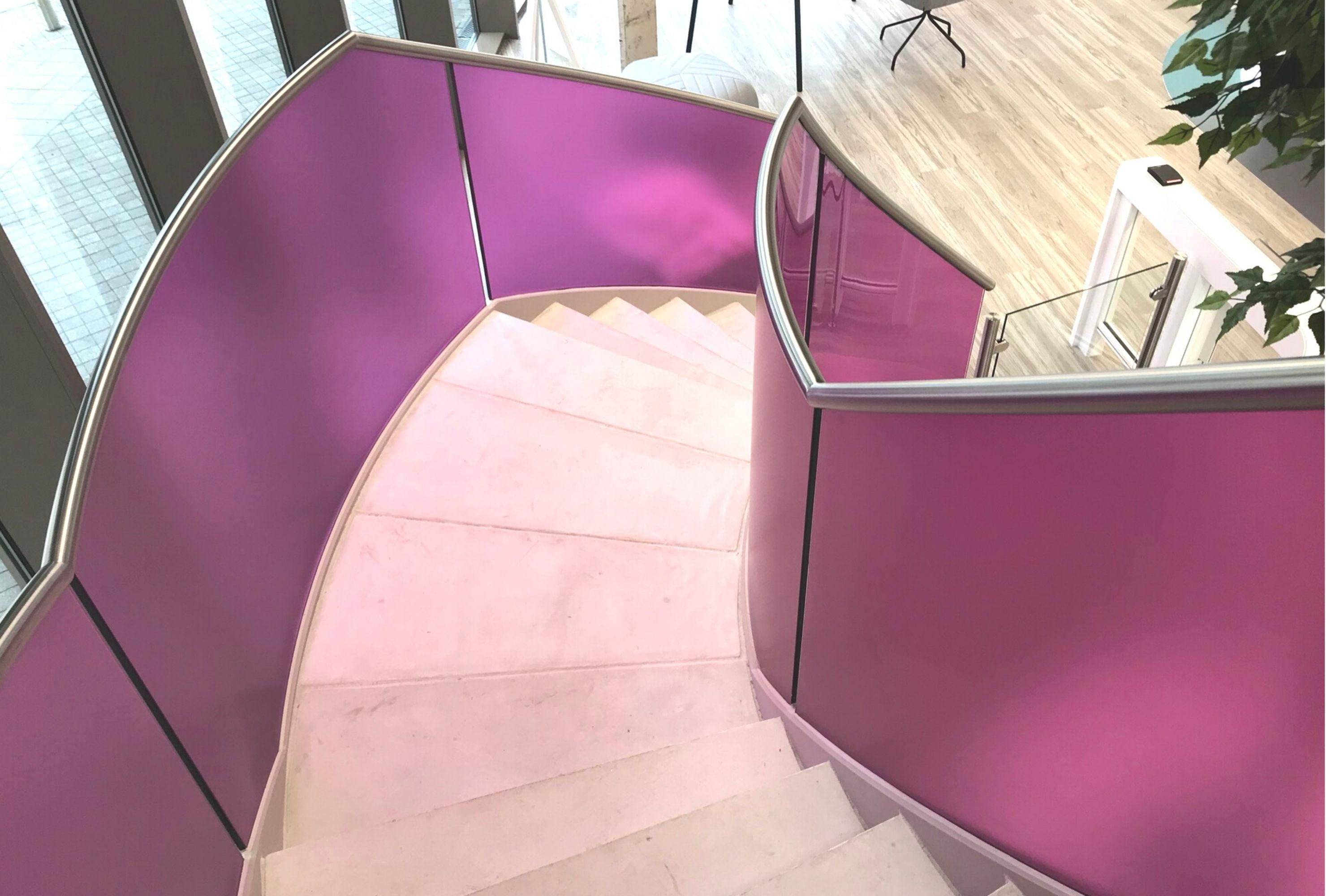 Concrete treads with pink balustrade