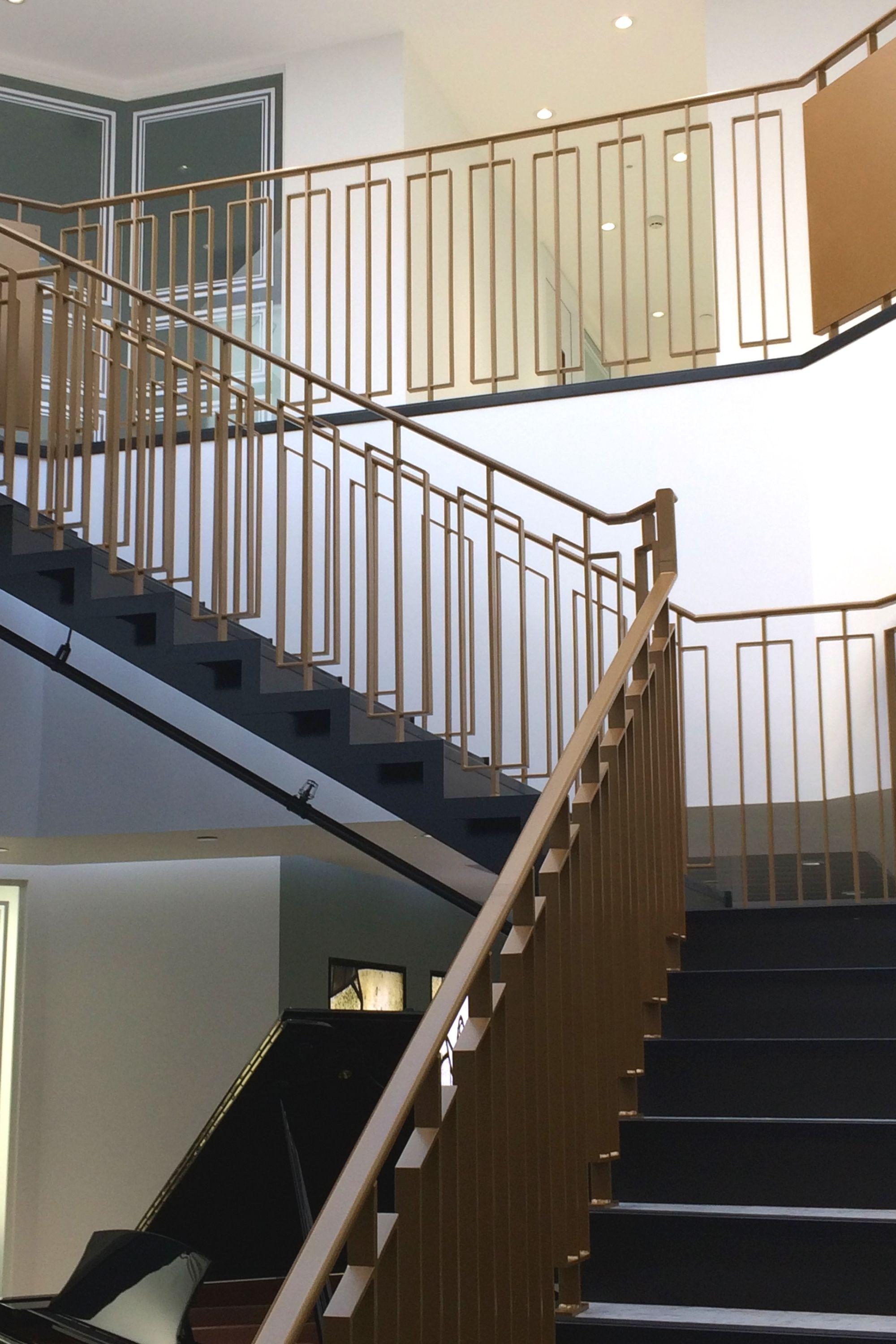 Bronze landing and staircase balustrade