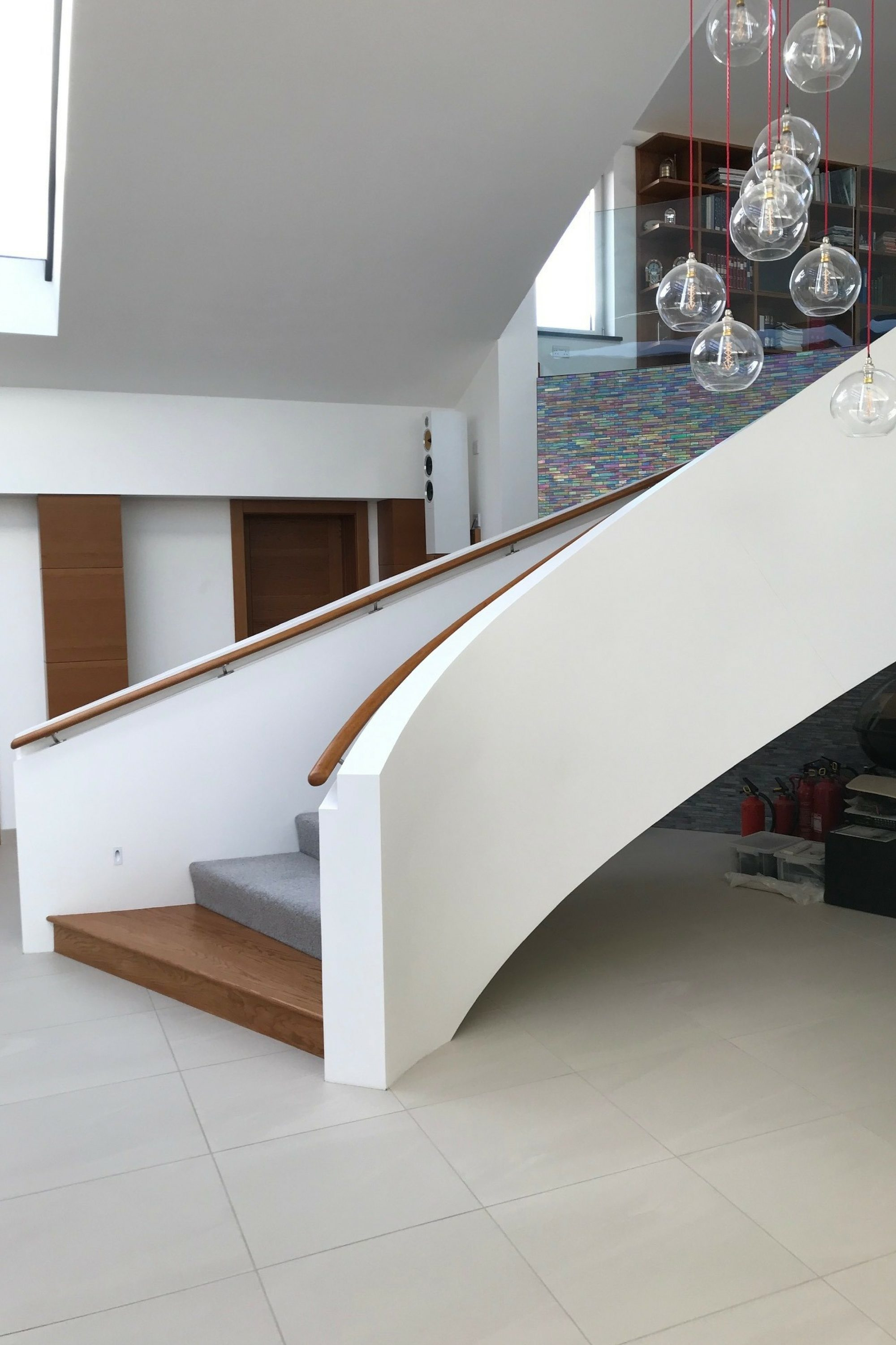 Curved stair with solid balustrade