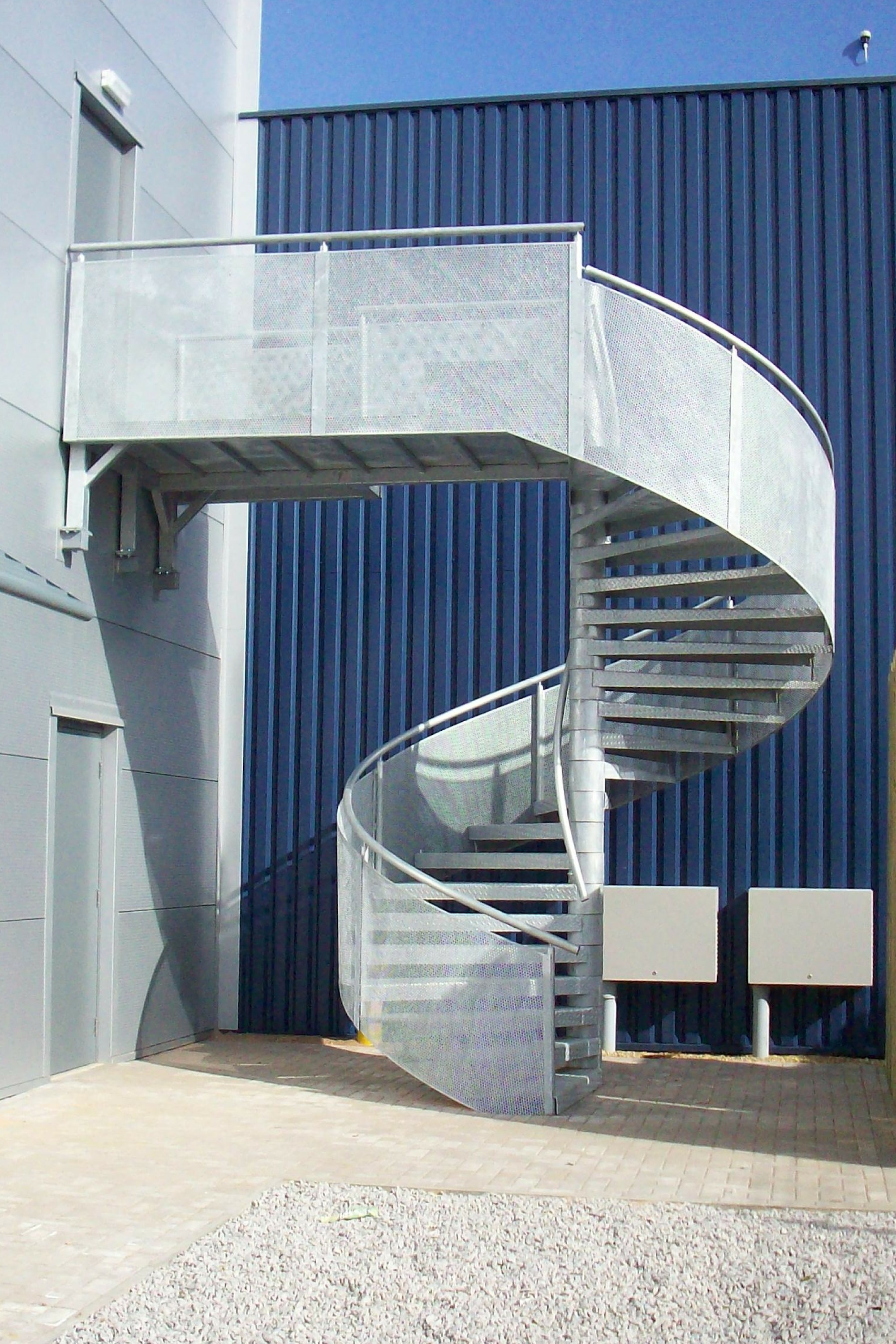Steel spiral staircase with enclosure