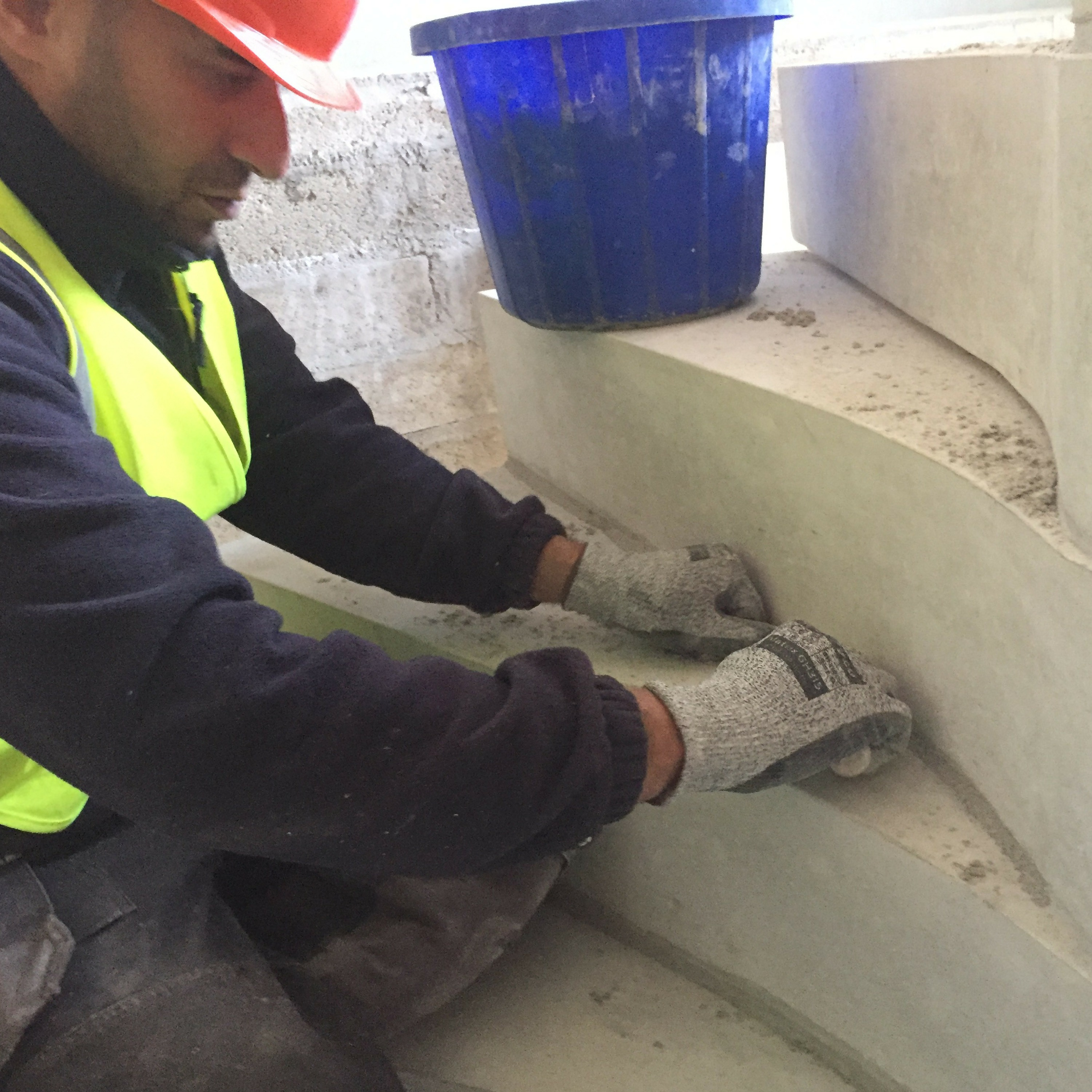 Staircase fitter working on concrete tread