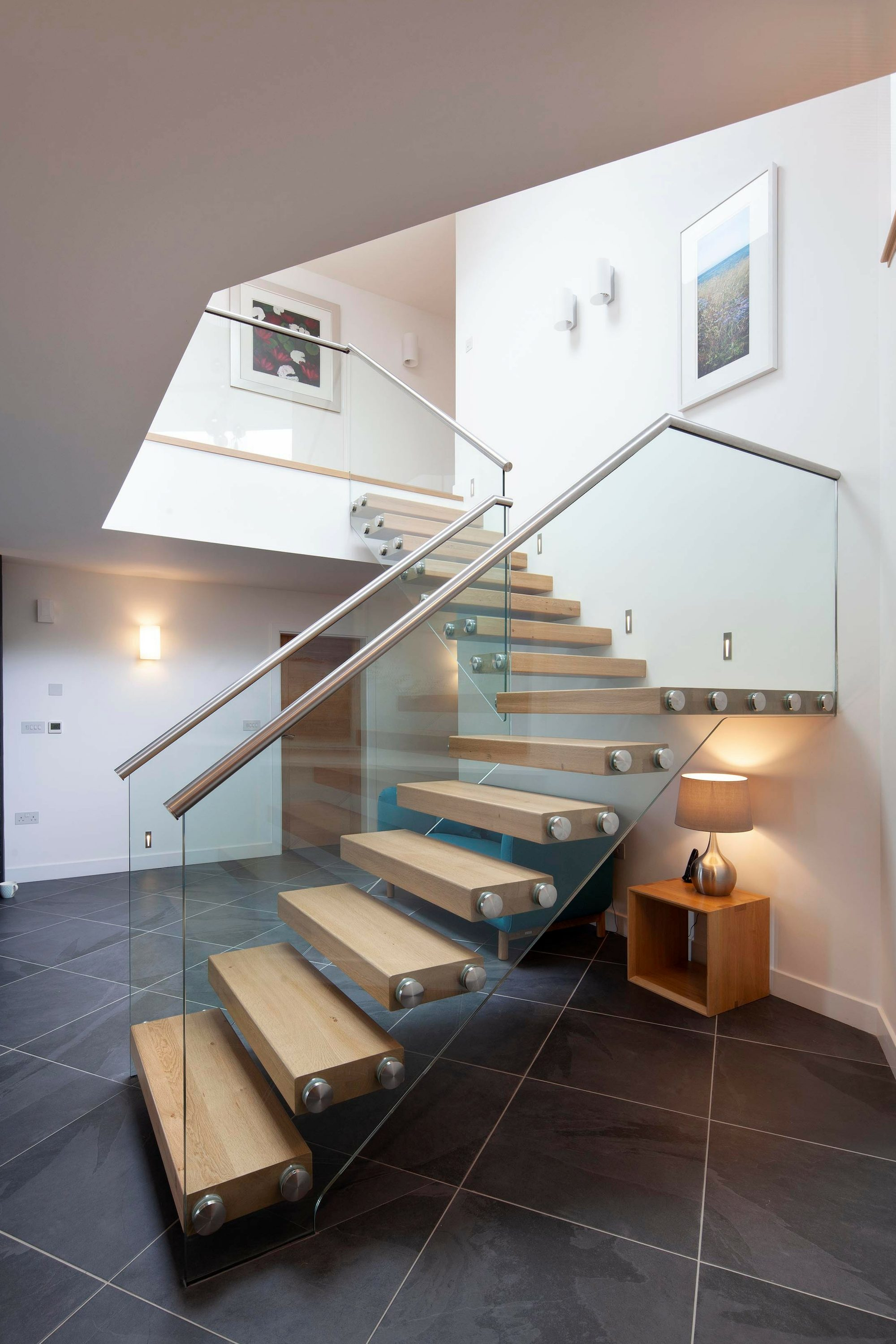 Timber tread and glass balustrade cantilever staircase