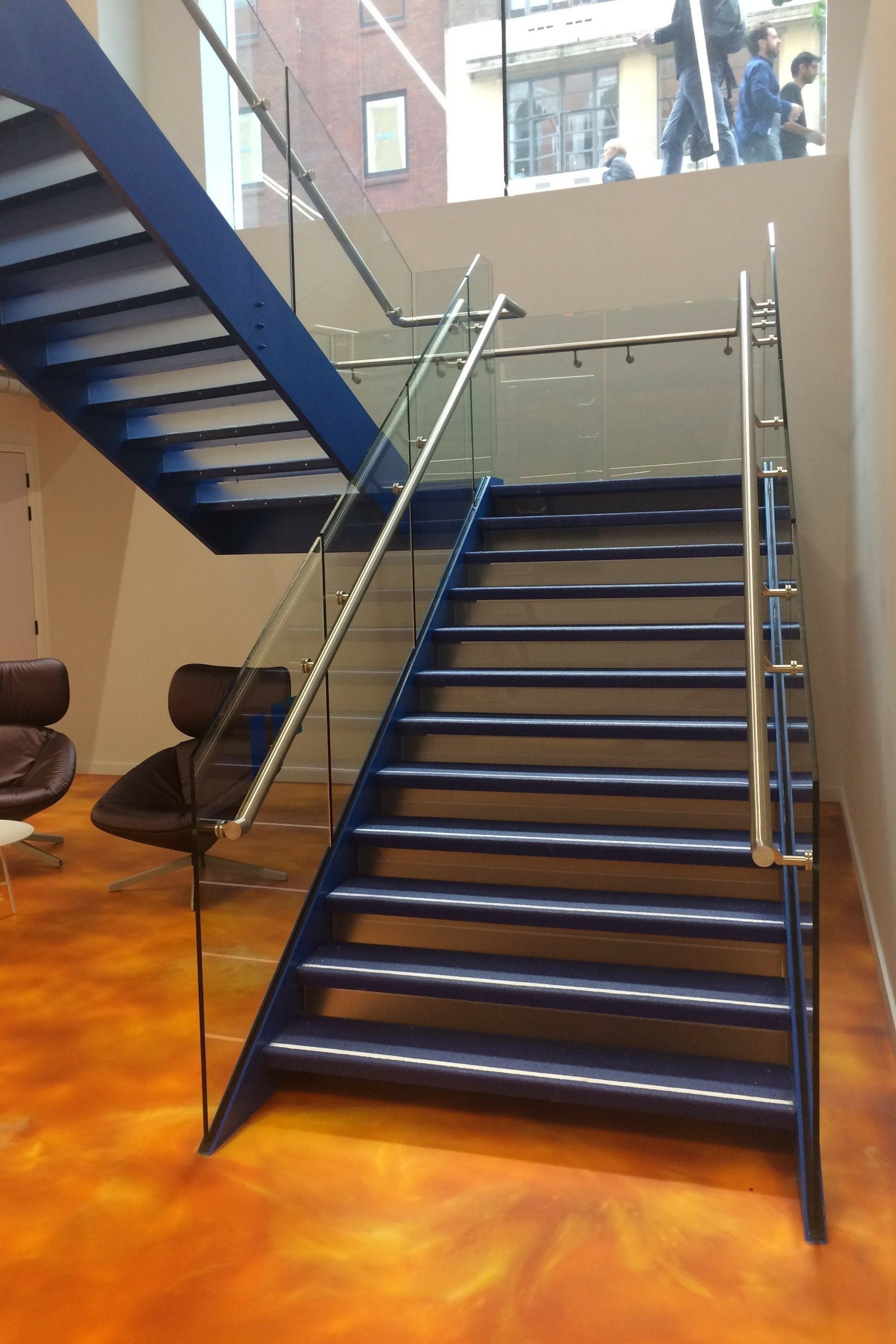 Blue tapered straight stair
