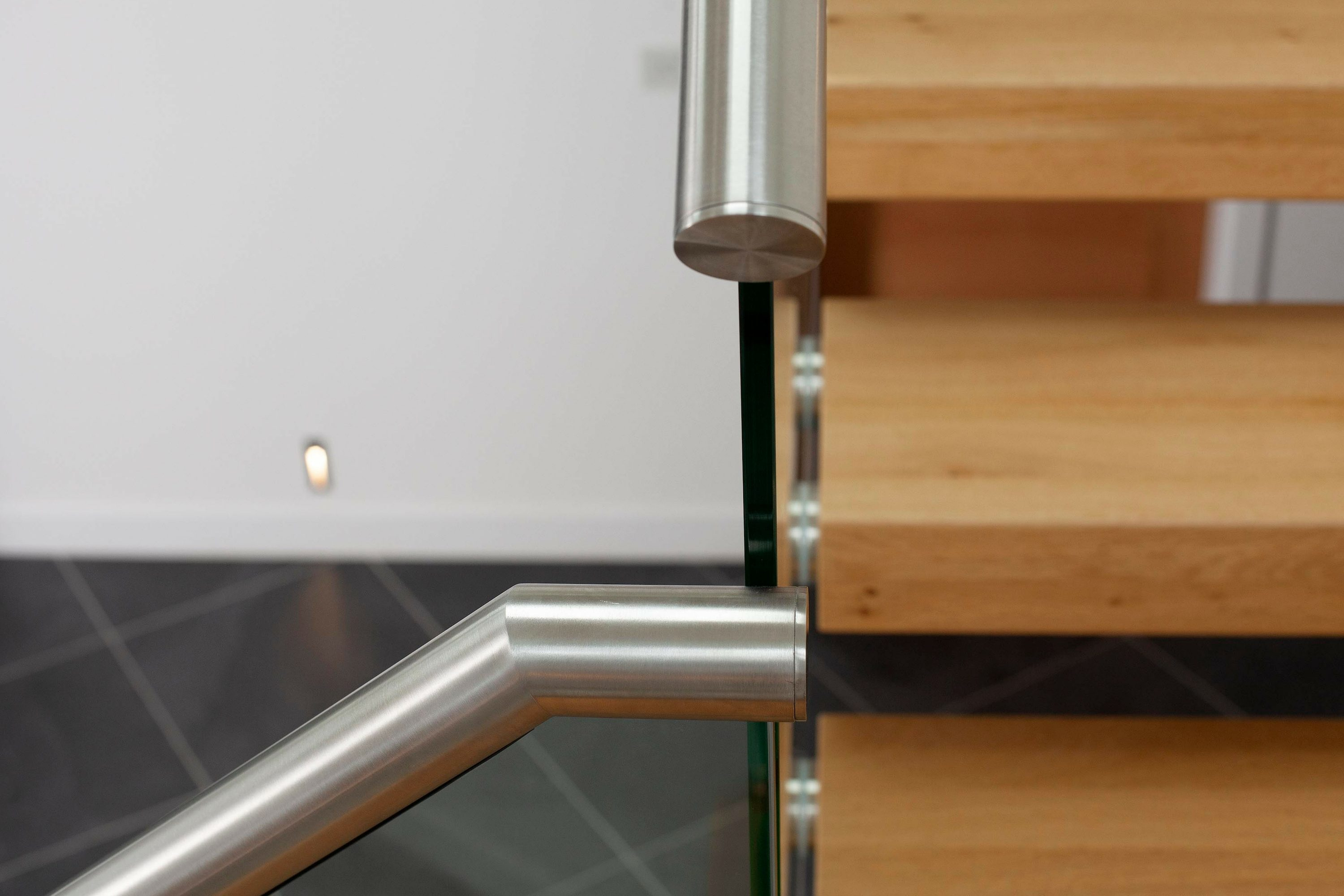 stainless steel handrail and timber tread